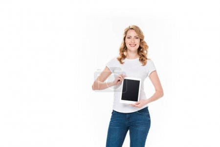 Photo for Portrait of smiling woman showing digital tablet with blank screen isolated on white - Royalty Free Image