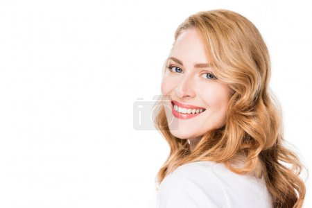 portrait of attractive smiling woman looking at camera isolated on white
