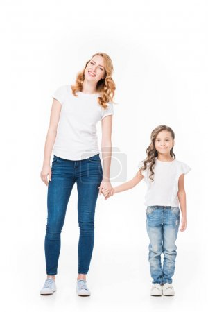 Photo for Cheerful mother and little daughter holding hands isolated on white - Royalty Free Image