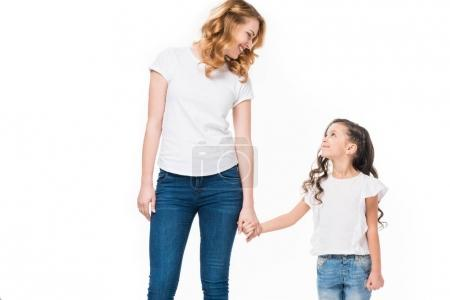 Photo for Smiling mother and little daughter holding hands isolated on white - Royalty Free Image