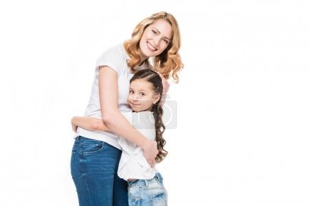 portrait of happy family hugging each other isolated on white