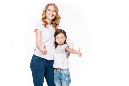 Photo for Portrait of smiling mother and daughter showing thumbs up isolated on white - Royalty Free Image