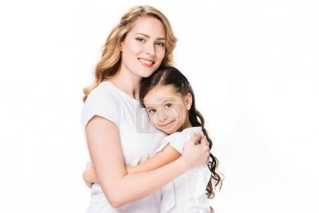 portrait of smiling mother and daughter hugging each other isolated on white