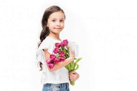 Photo pour Portrait d'enfant mignon avec bouquet de fleurs dans les mains isolé sur blanc, concept de fête des mères - image libre de droit
