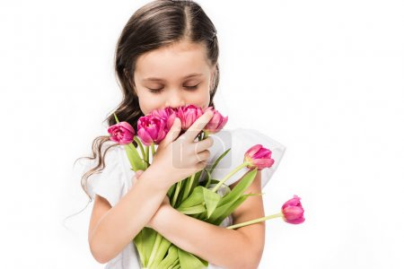 portrait of cute child with bouquet of flowers in hands isolated on white, mothers day concept