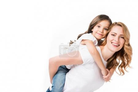 Photo for Happy mother and daughter piggybacking together isolated on white - Royalty Free Image