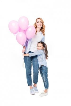smiling mother and daughter with pink balloons isolated on white