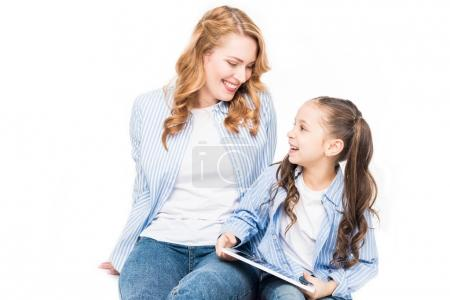 portrait of smiling family with digital tablet isolated on white