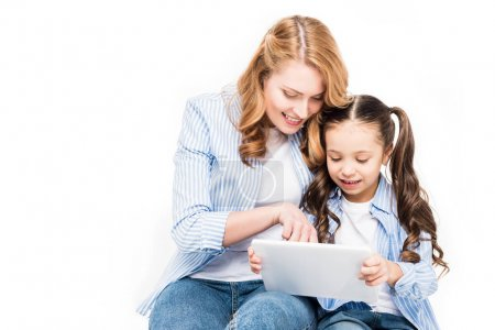 Photo for Portrait of mother and daughter using tablet together isolated on white - Royalty Free Image