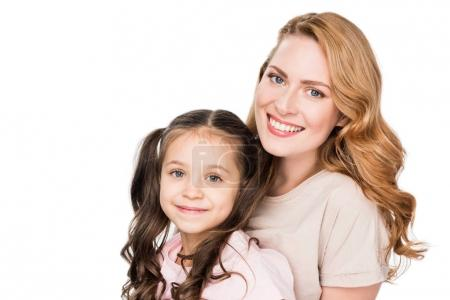 portrait of smiling mother and daughter isolated on white