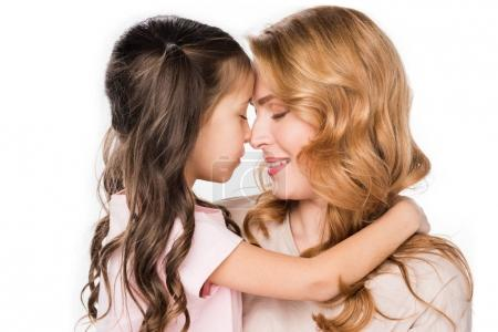 cute daughter hugging smiling mother isolated on white