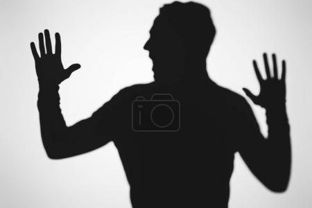 Photo for Scary blurry shadow of person screaming on grey - Royalty Free Image