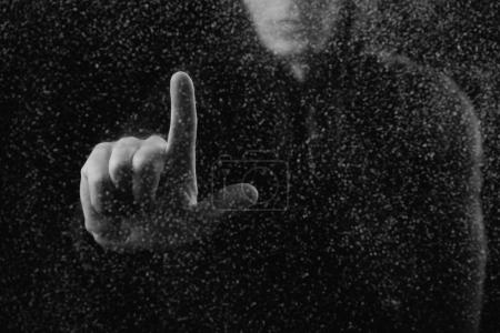cropped shot of person touching frosted glass with finger