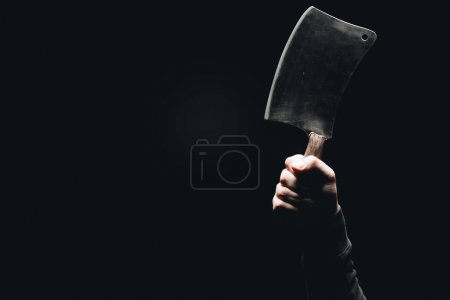 cropped shot of human hand holding meat knife isolated on black