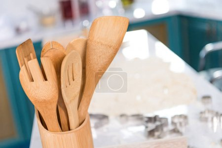 close-up view of wooden utensils in container in kitchen