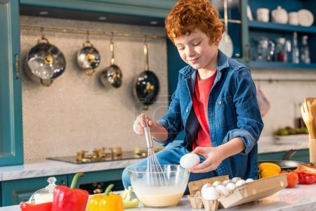 Photo for Cute smiling little boy preparing dough in kitchen - Royalty Free Image
