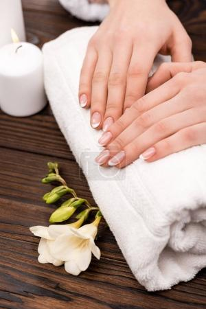 cropped view of woman making medicine and spa procedure in beauty salon