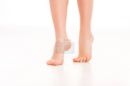 low section of barefoot female legs, isolated on white