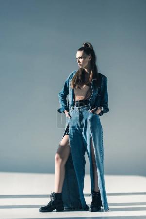 beautiful stylish woman in trendy denim clothes