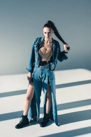 beautiful young woman in trendy denim clothes