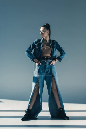 beautiful young woman in denim posing for fashion shoot
