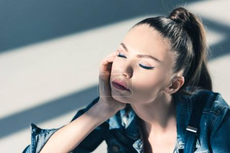 beautiful woman with closed eyes with blue makeup