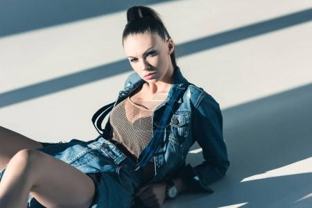 stylish young woman posing in trendy denim clothes