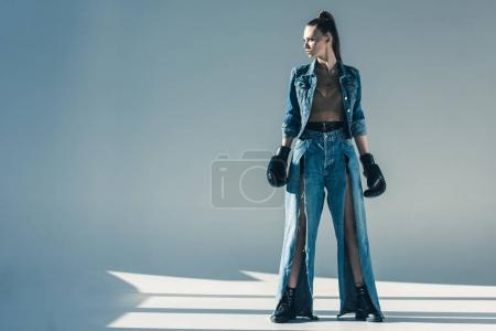 beautiful model in denim clothes with boxing gloves
