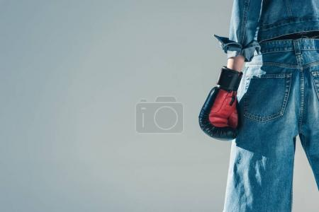 cropped view of girl in jeans and boxing gloves, isolated on grey