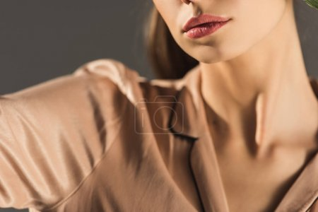 cropped view of girl in stylish blouse, isolated on grey