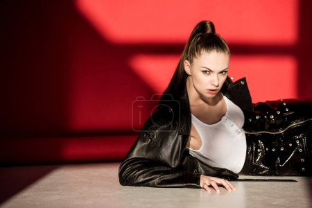 beautiful fashionable woman posing in black leather jacket