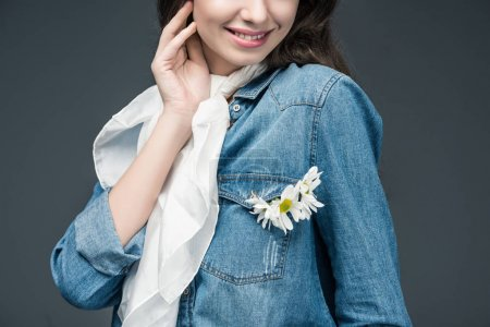 cropped view of smiling girl in scarf and denim shirt with flowers, isolated on grey