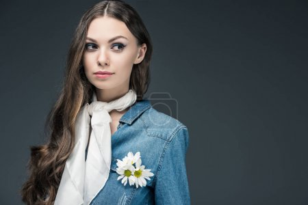 Photo for Attractive girl with long hair posing in scarf and denim shirt with flowers, isolated on grey - Royalty Free Image