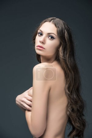 beautiful naked girl with long hair, isolated on grey