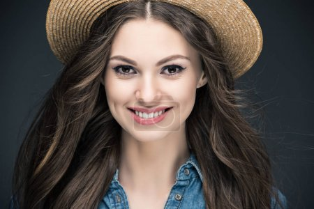 Photo for Attractive smiling girl with long hair in straw hat, isolated on grey - Royalty Free Image