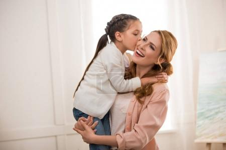 Photo for Cute little child kissing happy mother at home - Royalty Free Image
