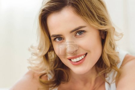 Photo for Portrait of beautiful happy woman with blond hair looking at camera - Royalty Free Image