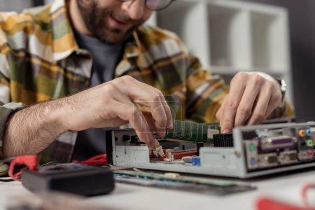 caucasian man reapairing repairing computer
