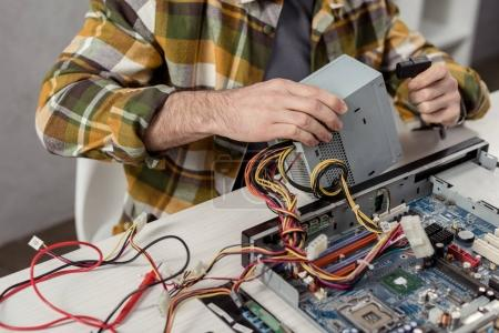 Photo for Cropped image of repairman fixing computer part - Royalty Free Image