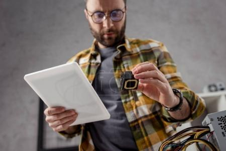 man with digital tablet and detail in hands