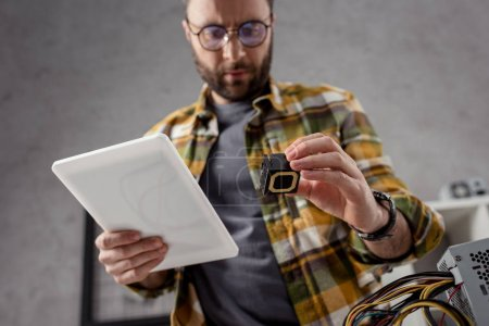 Photo for Man with digital tablet and detail in hands - Royalty Free Image