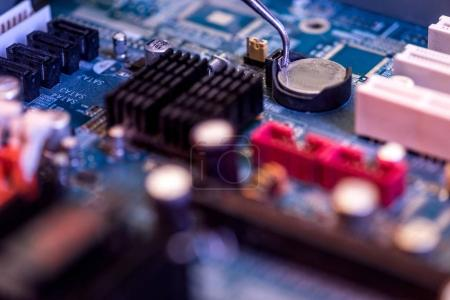 Photo for Close up of motherboard and battery in socket - Royalty Free Image
