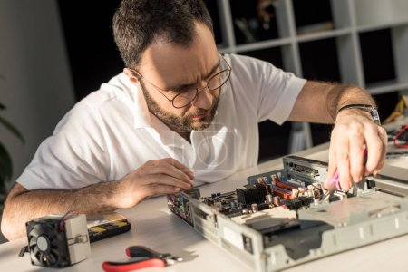 Photo for Man fixing computer motherboard - Royalty Free Image