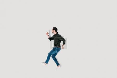 top view of stylish young man walking isolated on white
