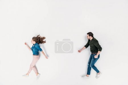 top view of man and woman pretending to walk isolated on white