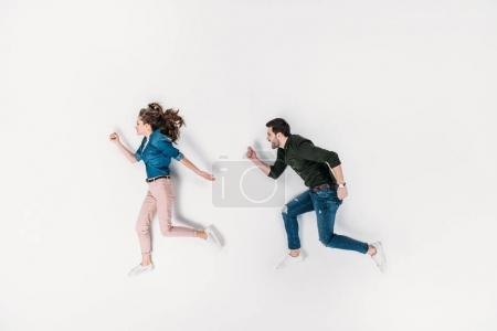 top view of couple pretending to run isolated on white