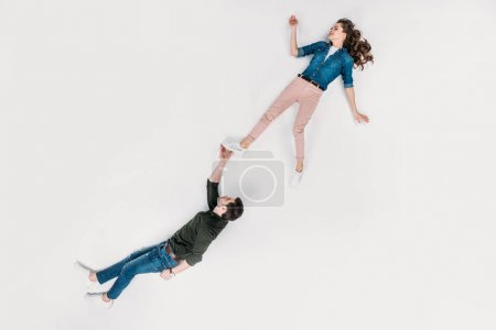 Photo for Top view of handsome man carrying his girlfriend with one hand isolated on white - Royalty Free Image