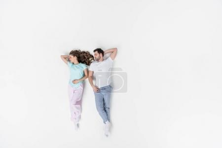 top view of couple in pajamas sleeping together isolated on white