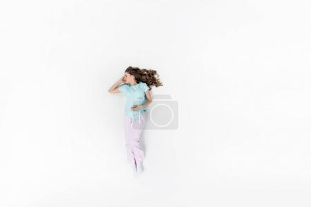 top view of beautiful young woman in pajamas sleeping isolated on white