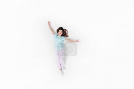 Photo for Top view of beautiful young woman in pajamas stretching isolated on white - Royalty Free Image